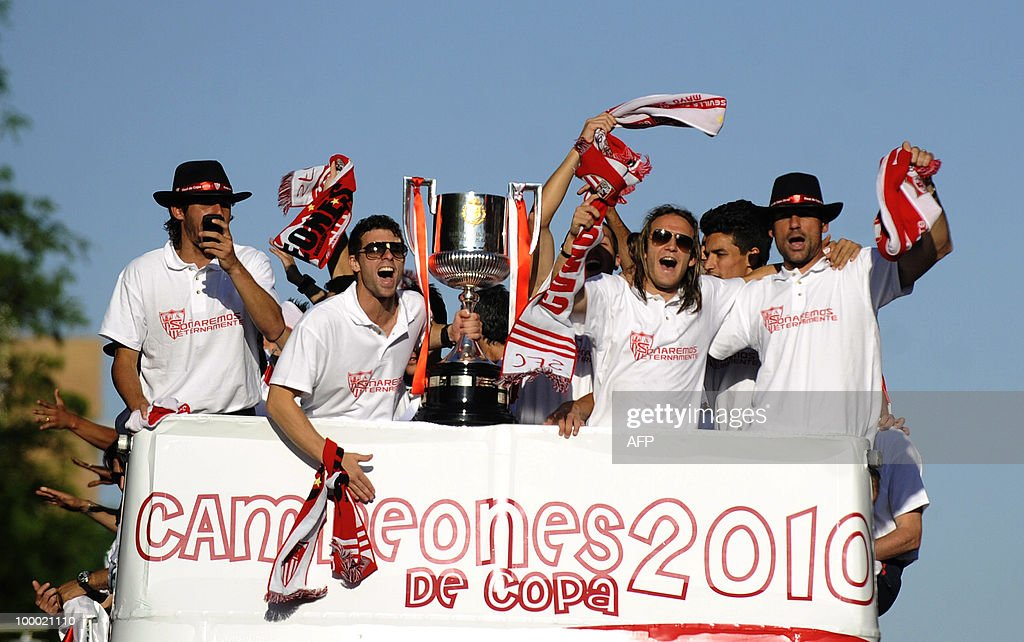 Sevilla's players celebrate with their trophy after winning the King's Cup final match against Atletico Madrid, in Seville on May 20, 2010.