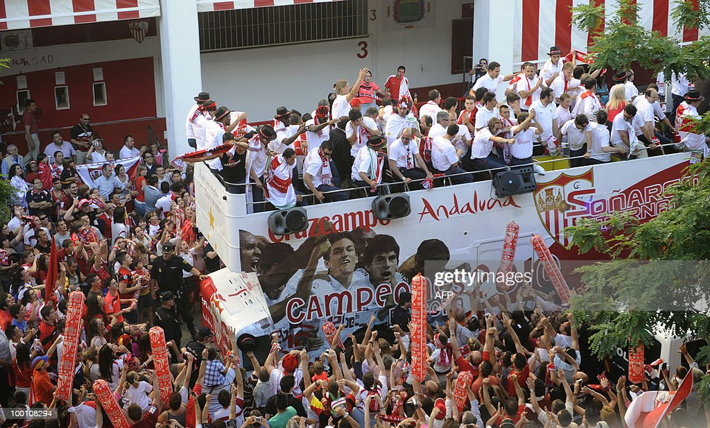 Sevilla's players celebrate with their t