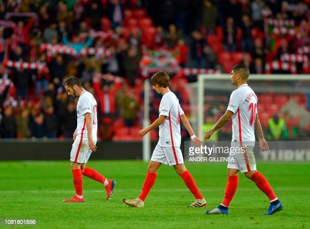 Sevilla's players leave the pitch after the Spanish League football match between Athletic Club Bilbao and Sevilla FC at the San Mames stadium in...