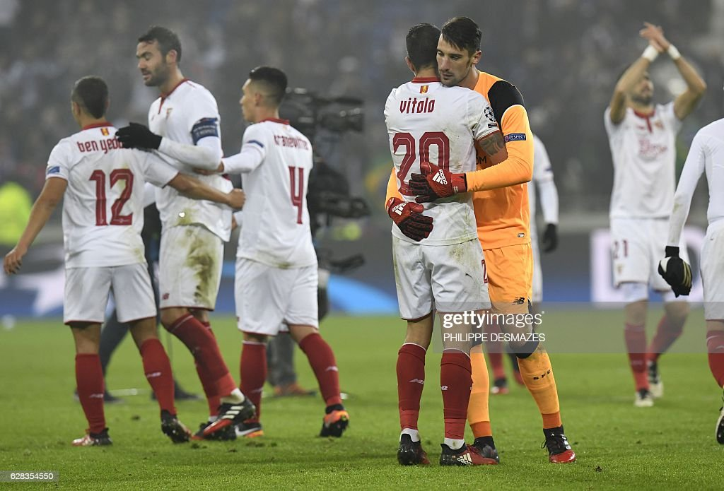 Sevilla's players reacts at the end of the UEFA Champions League Group H football match between Olympique Lyonnais (OL) and FC Sevilla at the Parc Olympique Lyonnais in Décines-Charpieu near Lyon, southeastern France, on December 7, 2016. Last season's Europa League winners Sevilla drew 0-0 with Lyon to take the runners-up spot in Group H. / AFP / PHILIPPE