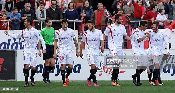 Sevilla's Polish midfielder Grzegorz Krychowiak celebrates with Sevilla's midfielder Vitolo Sevilla's Portuguese midfielder Daniel Carrico Sevilla's...