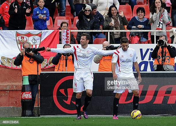 Sevilla's Polish midfielder Grzegorz Krychowiak celebrates with Sevilla's Portuguese midfielder Daniel Carrico after scoring during the Spanish...