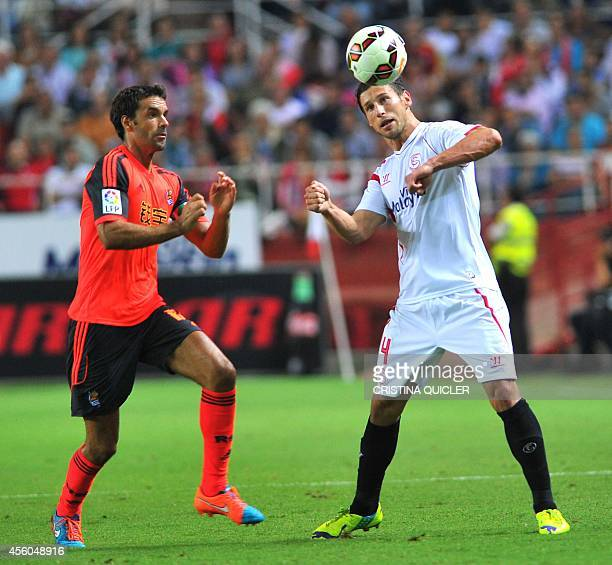Sevilla's Polish midfielder Grzegorz Krychowiak vies with Real Sociedad's Uruguayan forward Chory Castro during the Spanish league football match...