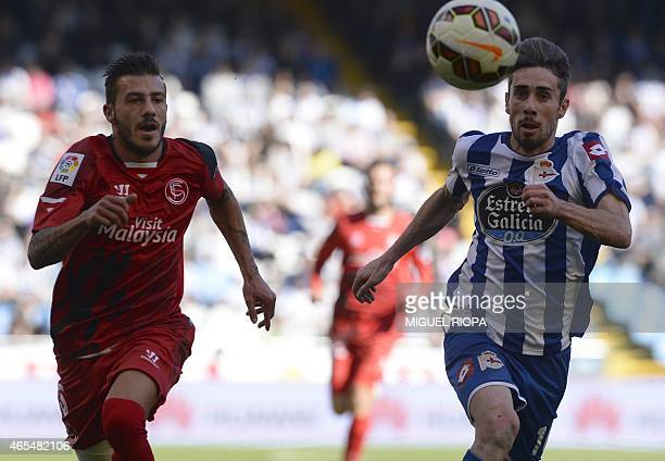Sevilla's Portuguese defender Diogo Figueiras vies with Deportivo's Portuguese defender Luisinho during the Spanish league football match RC...