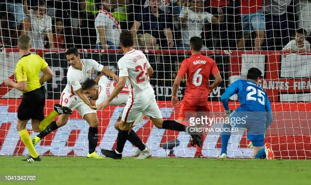 Sevilla's Portuguese forward Andre Silva celebrates after scoring a goal during the Spanish league football match Sevilla FC against Real Madrid CF...
