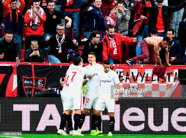 Sevilla's Portuguese forward Andre Silva celebrates after scoring during the Spanish league football match Sevilla FC against Real Valladolid FC at...