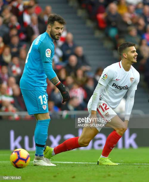 Sevilla's Portuguese forward Andre Silva gestures in front of Athletic Bilbao's Spanish goalkeeper Iago Herrerin during the Spanish League football...