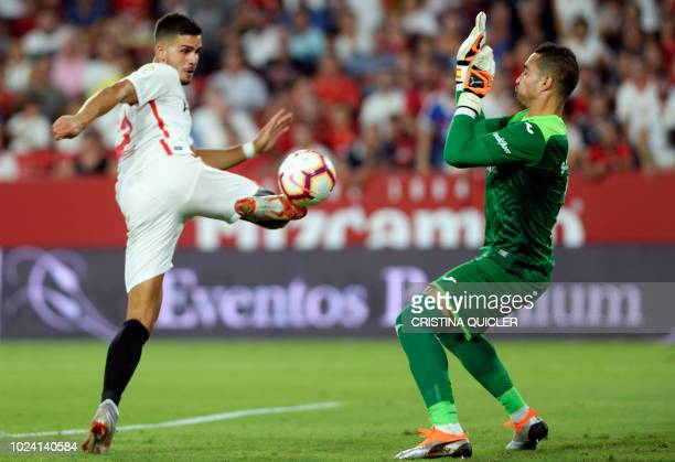 TOPSHOT Sevilla's Portuguese forward Andre Silva kicks the ball in front of Villarreal's Spanish goalkeeper Sergio during the Spanish league football...