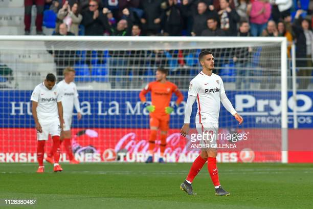 Sevilla's Portuguese forward Andre Silva reacts after Huesca scored a goal during the Spanish league football match between SD Huesca and Sevilla FC...