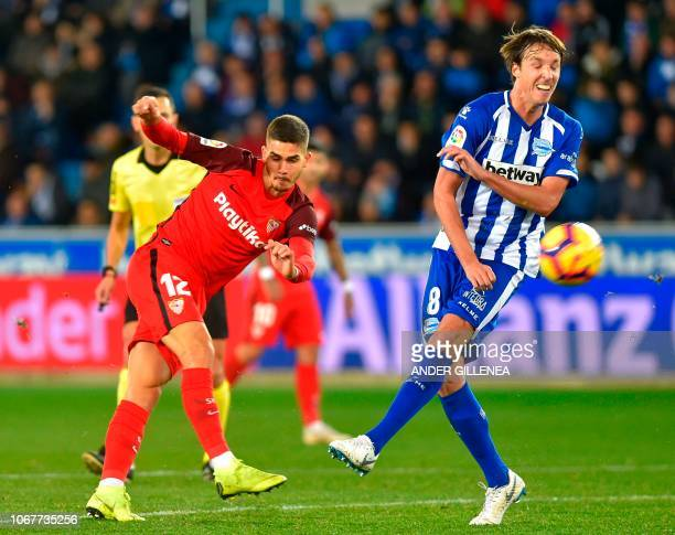 Sevilla's Portuguese forward Andre Silva vies with Alaves' Spanish midfielder Pina during the Spanish league football match Deportivo Alaves against...
