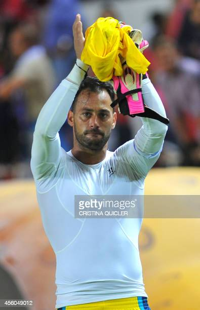 Sevilla's Portuguese goalkeeper Beto applauds at the end of the Spanish league football match Sevilla FC vs Real Sociedad at the Ramon Sanchez...