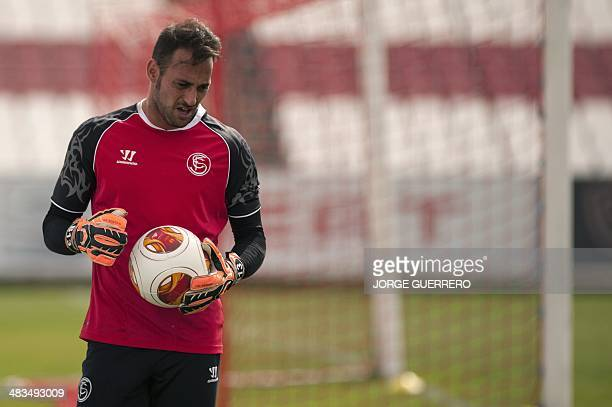 Sevilla's Portuguese goalkeeper Beto holds a ball during a training session at the training ground in Sevilla on April 9 2014 on the eve of the UEFA...