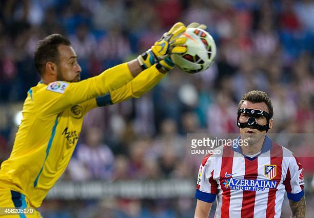 Sevilla's Portuguese goalkeeper Beto vies with Atletico Madrid's Croatian forward Mario Mandzukic during the Spanish league football match Club...