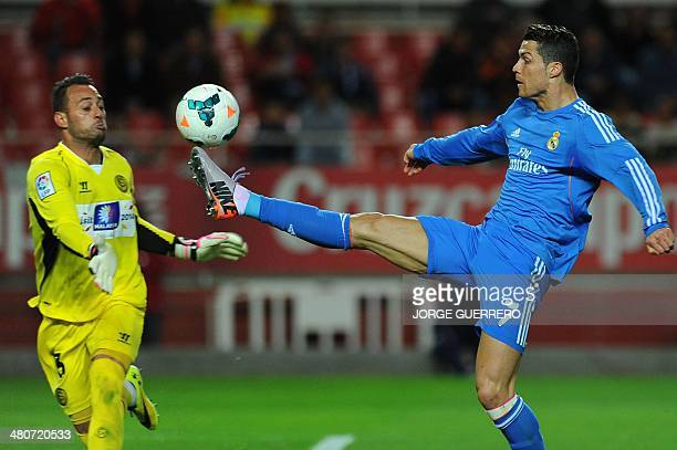 Sevilla's Portuguese goalkeeper Beto vies with Real Madrid's Portuguese forward Cristiano Ronaldo during the Spanish league football match Sevilla FC...