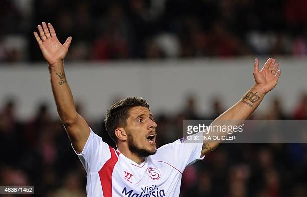 Sevilla's Portuguese midfielder Daniel Carrico reacts during the UEFA Europa League football match Sevilla FC vs VfL Borussia Monchengladbach at the...