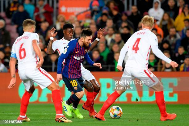 Sevilla's Portuguese midfielder Daniel Carrico Sevilla's Dutch midfielder Quincy Promes and Sevilla's Danish defender Simon Kjaer vie for the ball...