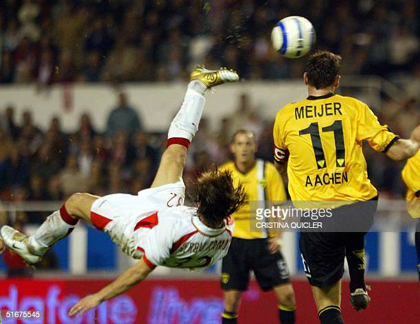 Sevilla's Sergio Ramos jumps for the ball with Aachen Erik Meijer during their UEFA Cup match at Sanchez Pizjuan stadium in Seville Spain 04 November...