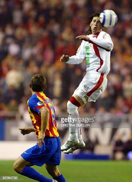 Sevilla's Sergio Ramos vies with Valencia's Brazilian Fabio Aurelio during the Spanish League football match in Sanchez Pizjuan stadium in Sevilla 2...