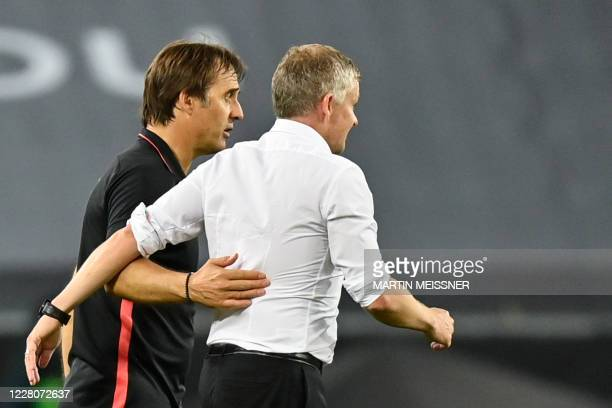 Sevilla's Spanish coach Julen Lopetegui and Manchester United's Norwegian manager Ole Gunnar Solskjaer embrace after the final whistle during the...