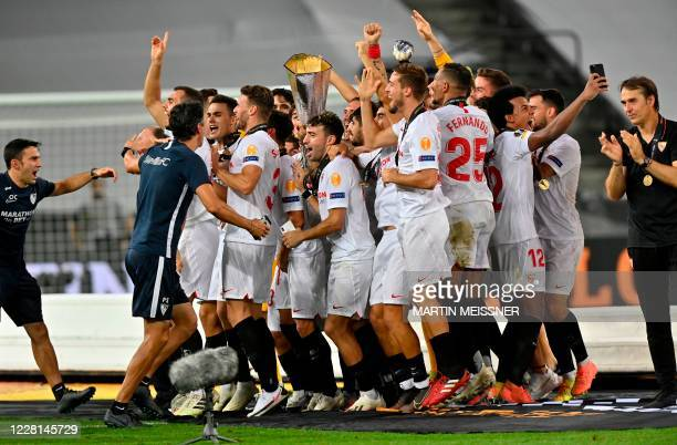 Sevilla's Spanish coach Julen Lopetegui and Sevilla's players celebrate with the trophy after winning the UEFA Europa League final football match...