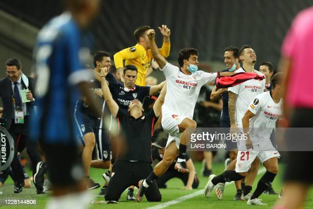 Sevilla's Spanish coach Julen Lopetegui kneels as he celebrates with players after Sevilla won the UEFA Europa League final football match Sevilla v...