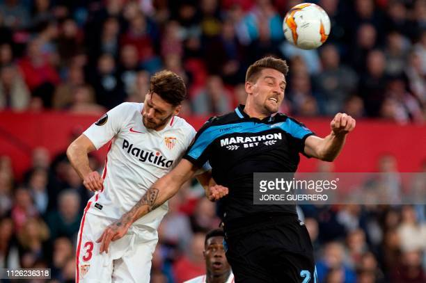 Sevilla's Spanish defender Sergi Gomez fights for the ball with Lazio's Serbian midfielder Sergej MilinkovicSavic during the UEFA Europa League round...