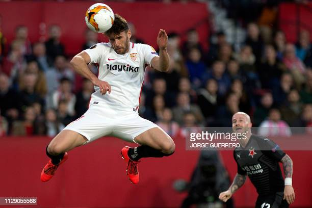 TOPSHOT Sevilla's Spanish defender Sergi Gomez heads the ball during the Europa League round of 16 first leg football match between Sevilla FC and...