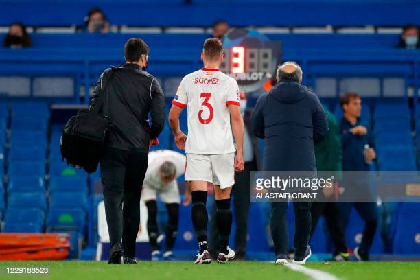Sevilla's Spanish defender Sergi Gomez is substituted in the first half during the UEFA Champions League first round Group E football match between...