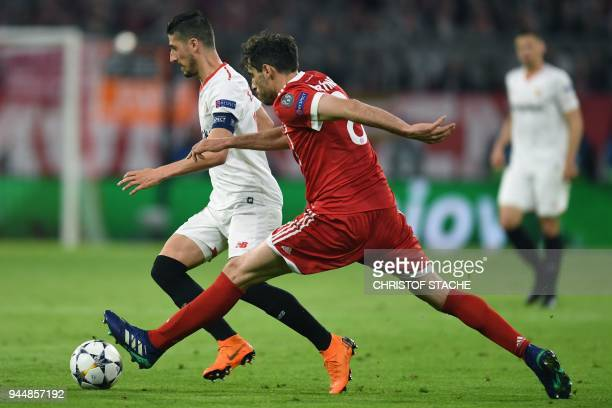 Sevilla's Spanish defender Sergio Escudero and Bayern Munich's Spanish midfielder Javier Martinez vie for the ball during the UEFA Champions League...