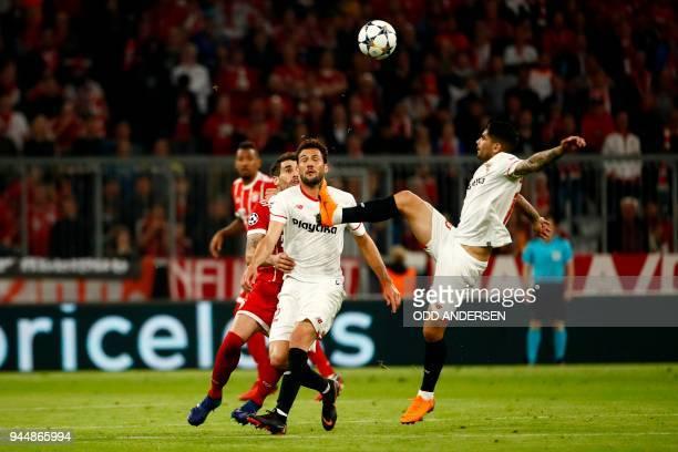 Sevilla's Spanish defender Sergio Escudero vies with teammate Argentinian midfielder Joaquin Correa during the UEFA Champions League quarterfinal...