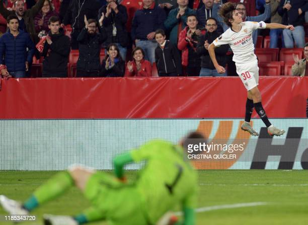 Sevilla's Spanish forward Bryan Gil celebrates after scoring a goal during the UEFA Europa League Group A football match between Sevilla FC and...