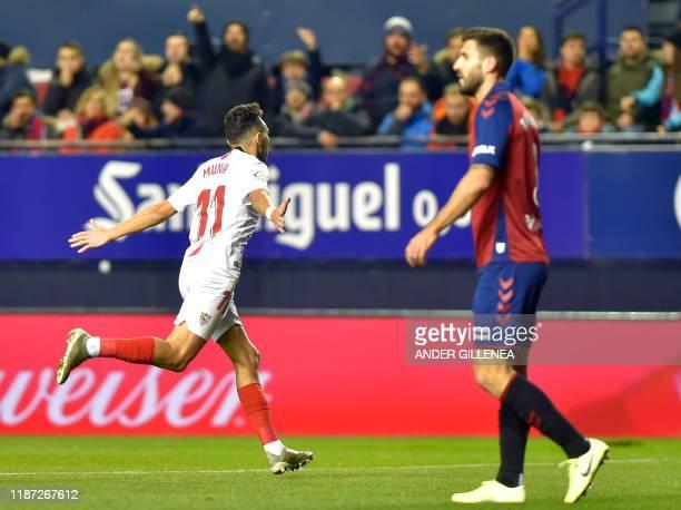 Sevilla's Spanish forward Munir El Haddadi celebrates after scoring a goal during the Spanish league football match between CA Osasuna and Sevilla FC...