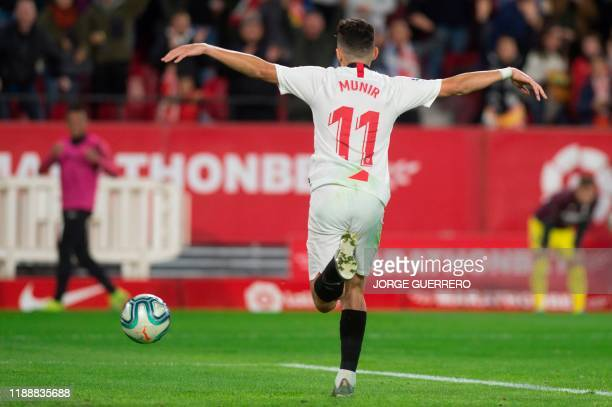 Sevilla's Spanish forward Munir El Haddadi celebrates after scoring a goal during the Spanish league football match between Sevilla FC and Villarreal...