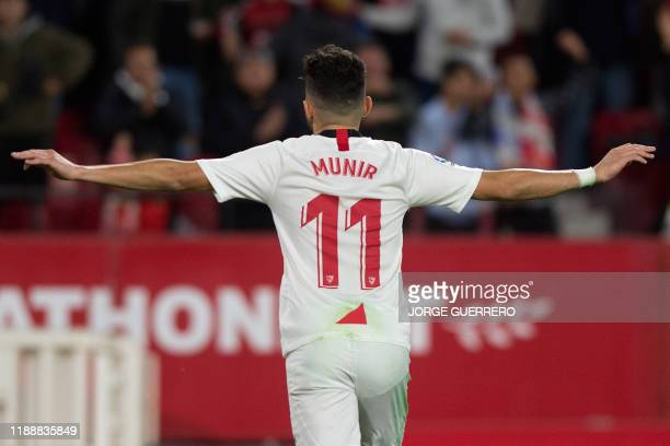 Sevilla's Spanish forward Munir El Haddadi celebrates after scoring a goal during the Spanish league football match between Sevilla FC and Villarreal...