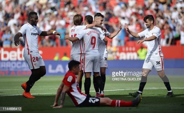 Sevilla's Spanish forward Munir El Haddadi celebrates with teammates after scoring a goal during the Spanish League football match between Sevilla...