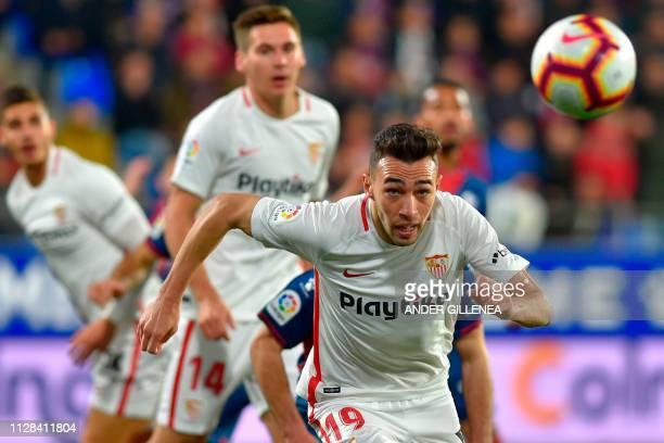 Sevilla's Spanish forward Munir El Haddadi runs with the ball during the Spanish league football match between SD Huesca and Sevilla FC at the El...