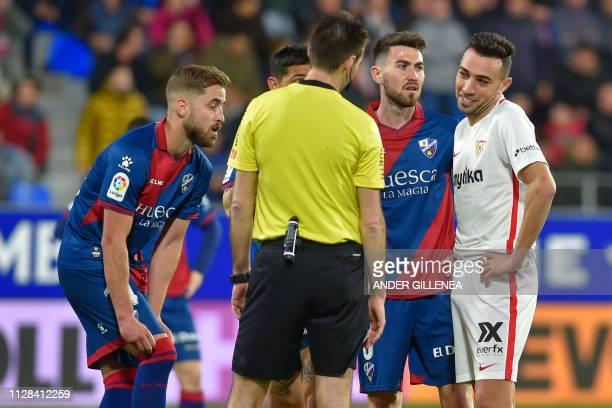 Sevilla's Spanish forward Munir El Haddadi speaks to Spanish referee Ricardo De Burgos Bengoetxea during the Spanish league football match between SD...