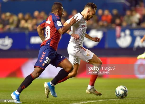 Sevilla's Spanish forward Munir El Haddadi vies with Osasuna's Ecuadorian defender Pervis Estupinan during the Spanish league football match between...