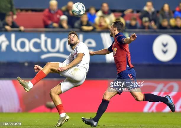 Sevilla's Spanish forward Munir El Haddadi vies with Osasuna's Spanish midfielder Oier Sanjurjo during the Spanish league football match between CA...
