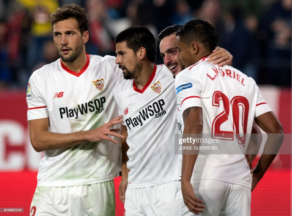 Sevilla's Spanish forward Nolito (2L) celebrates a goal with Argentinian midfielder Franco Vazquez (L), Spanish midfielder Pablo Sarabia (2R) and Colombian forward Luis Muriel during the Spanish league football match Sevilla vs Celta Vigo at the Ramon Sanchez Pizjuan stadium in Sevilla on November 18, 2017. /
