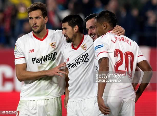 Sevilla's Spanish forward Nolito celebrates a goal with Argentinian midfielder Franco Vazquez Spanish midfielder Pablo Sarabia and Colombian forward...