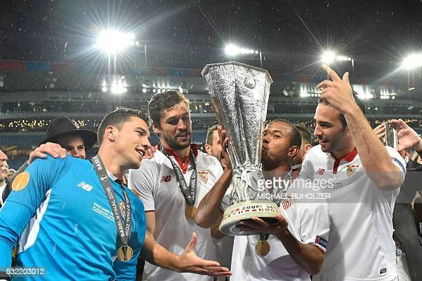 Sevilla's Spanish goalkeeper David Soria Sevilla's Spanish defender Fernando Llorente Sevilla's Brazilian defender Mariano Ferreira and Sevilla's...