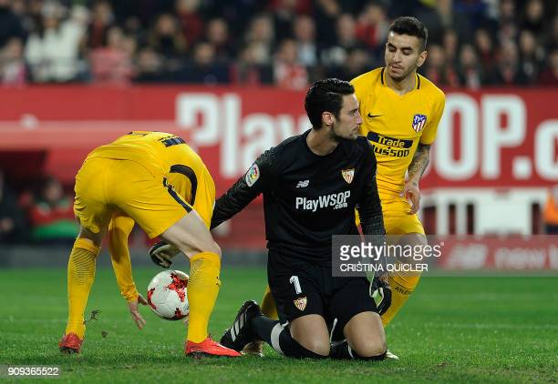 Sevilla's Spanish goalkeeper Sergio Rico Gonzalez reacts after conceding a goal during the Spanish 'Copa del Rey' quarterfinal second leg football...