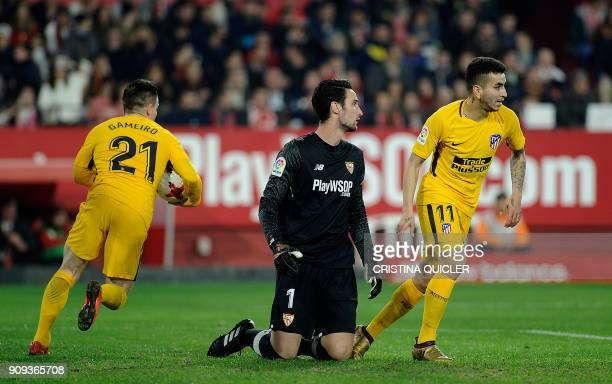 Sevilla's Spanish goalkeeper Sergio Rico Gonzalez reacts as Atletico Madrid's French forward Kevin Gameiro and Atletico Madrid's Argentinian forward...