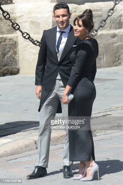 Sevilla's Spanish midfielder Jesus Navas and his wife Alejandra Moral arrive at the Cathedral of Seville on June 15 2019 to attend the wedding...
