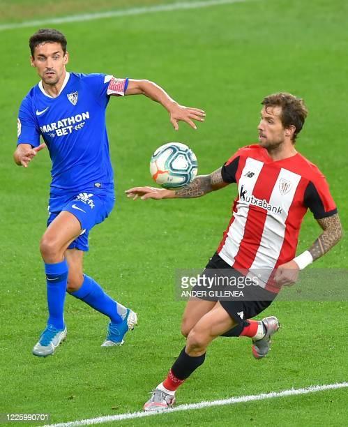Sevilla's Spanish midfielder Jesus Navas challenges Athletic Bilbao's Spanish defender Inigo Martinez during the Spanish League football match...