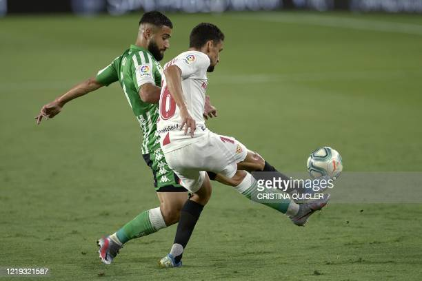 Sevilla's Spanish midfielder Jesus Navas challenges Real Betis' French midfielder Nabil Fekir during the Spanish League football match between...