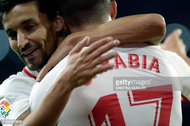 Sevilla's Spanish midfielder Jesus Navas congratulates Sevilla's Spanish midfielder Pablo Sarabia for his goal during the Spanish league football...