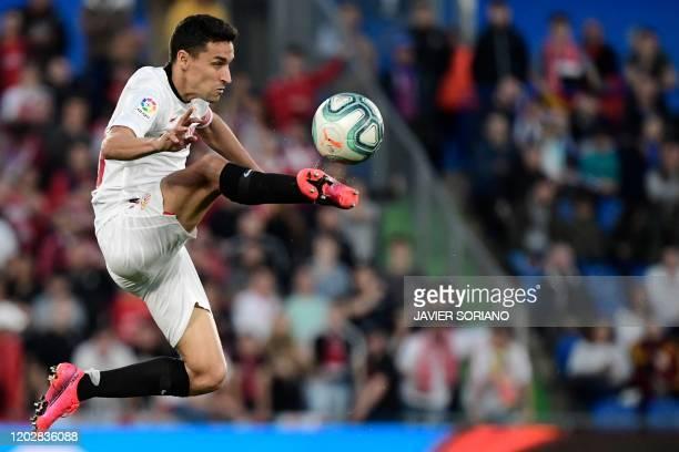 Sevilla's Spanish midfielder Jesus Navas jumps for the ball during the Spanish league football match Getafe CF against Sevilla FC at the Coliseum...