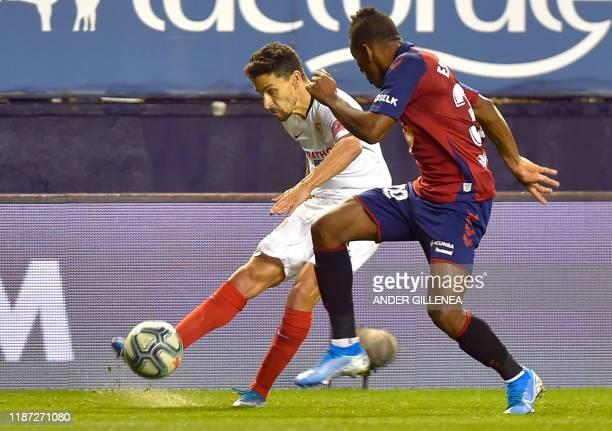 Sevilla's Spanish midfielder Jesus Navas vies with Osasuna's Ecuadorian defender Pervis Estupinan during the Spanish league football match between CA...